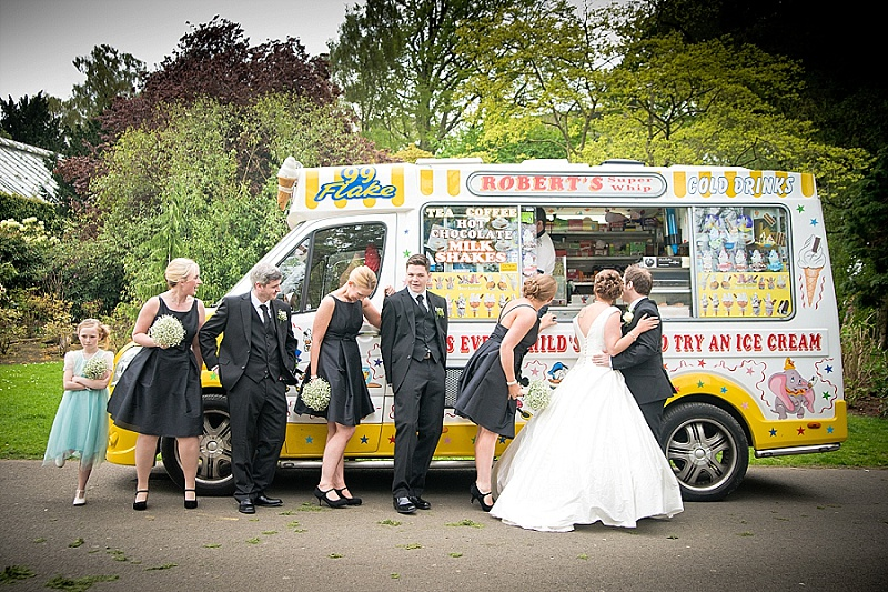 Bridal party stand in a queue for ice cream with an ice cream van