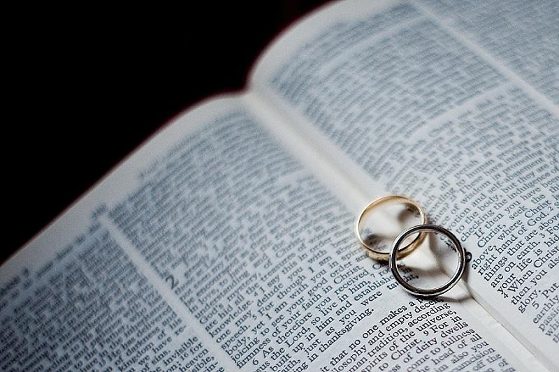 Wedding rings sitting on Bible