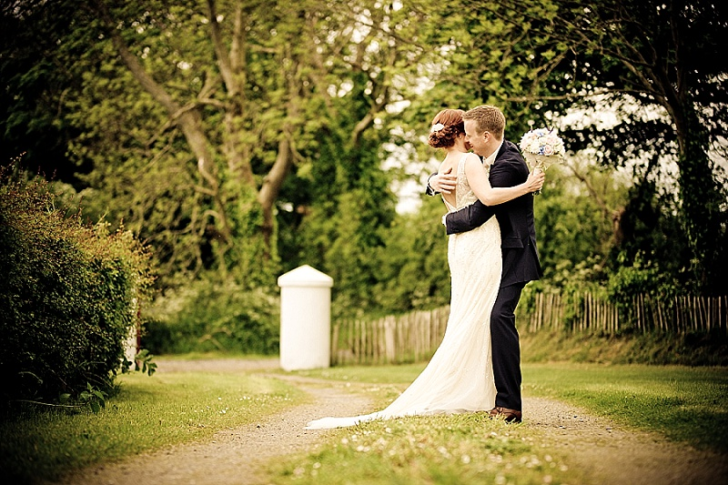 Vintage wedding dress couple kiss at farm