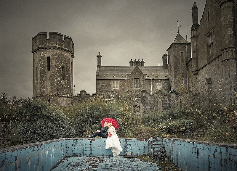 Wedding couple sit at urbex abandoned swimming pool