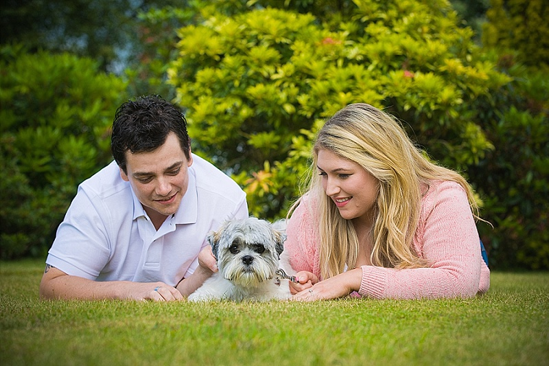 Engaged couple with their dog