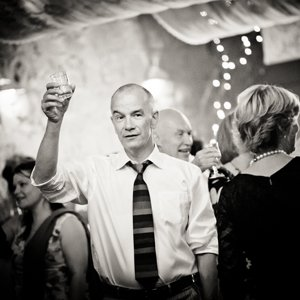 Guest raises a glass to a couple at a wedding