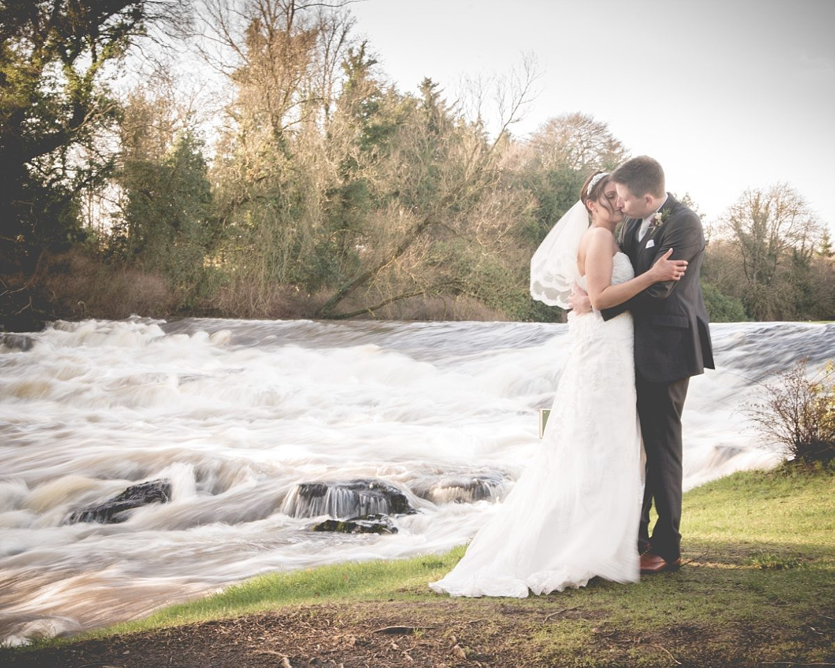 Bride and groom at the river at Galgorm