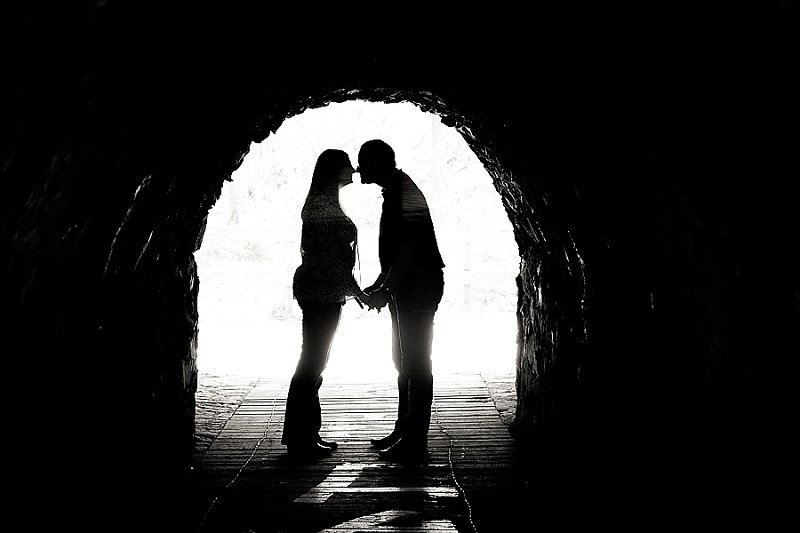 Silhouette of couple in love kissing