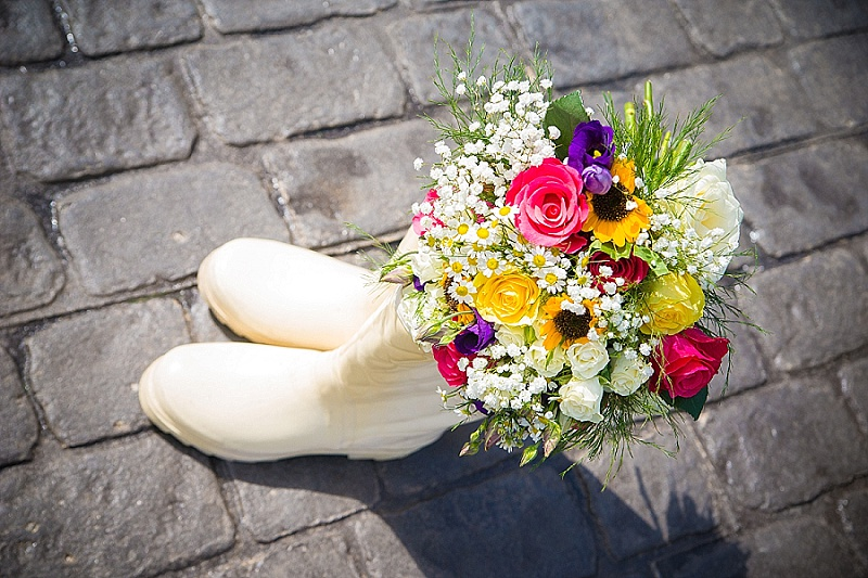 Vintage wedding wellington boot filled with colourful bridal flowers