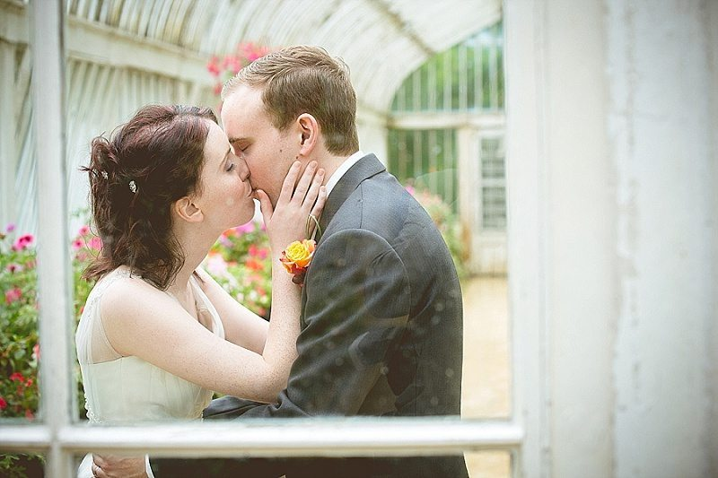 Bride and groom kiss at Botanical Gardens in Belfast