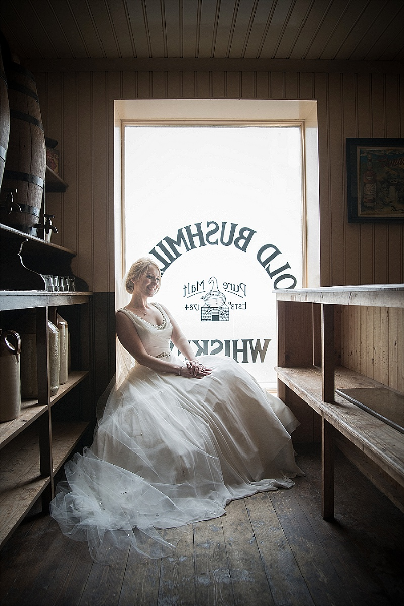 Vintage bride sits in old fashioned Irish bar window