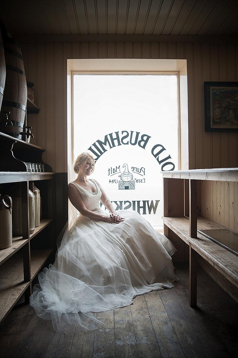 Vintage bride sits in old fashioned Irish bar window