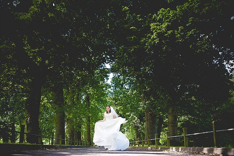 Bride in forest twirling her dress