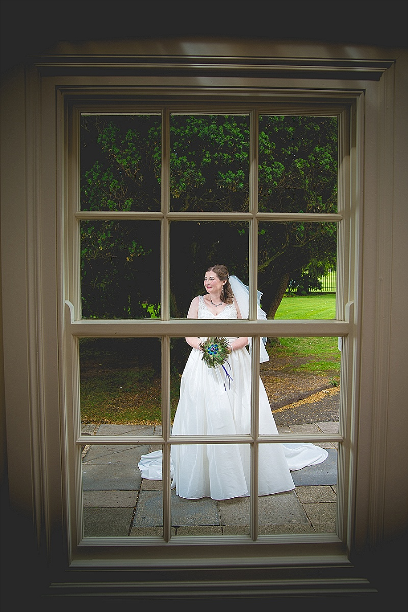 Bride through Georgian Window