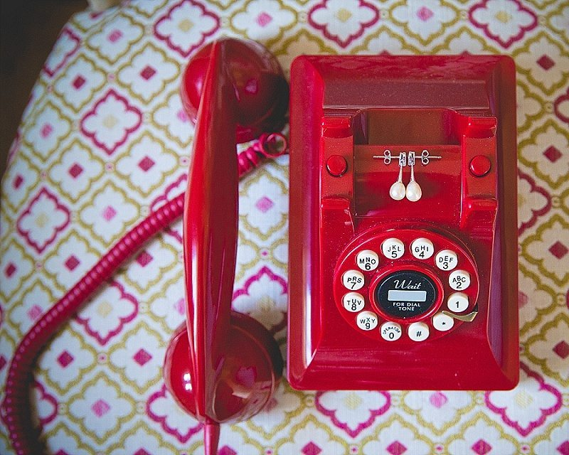Earrings on Red vintage phone