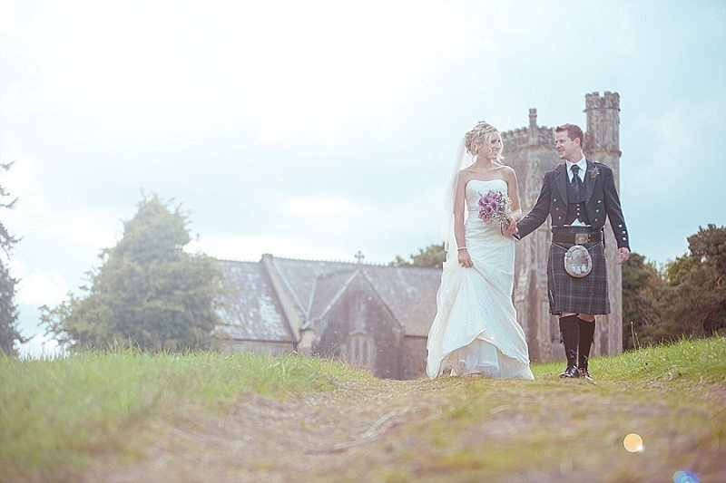 Bride and Groom walking down country church lane