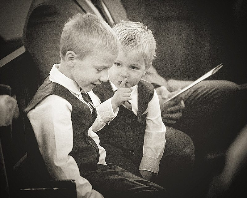 Little boys shushing in a church