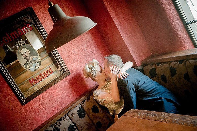 Bride and Groom Kissing in Irish Pub