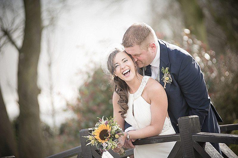 Bride and Groom Laughing on Bridge