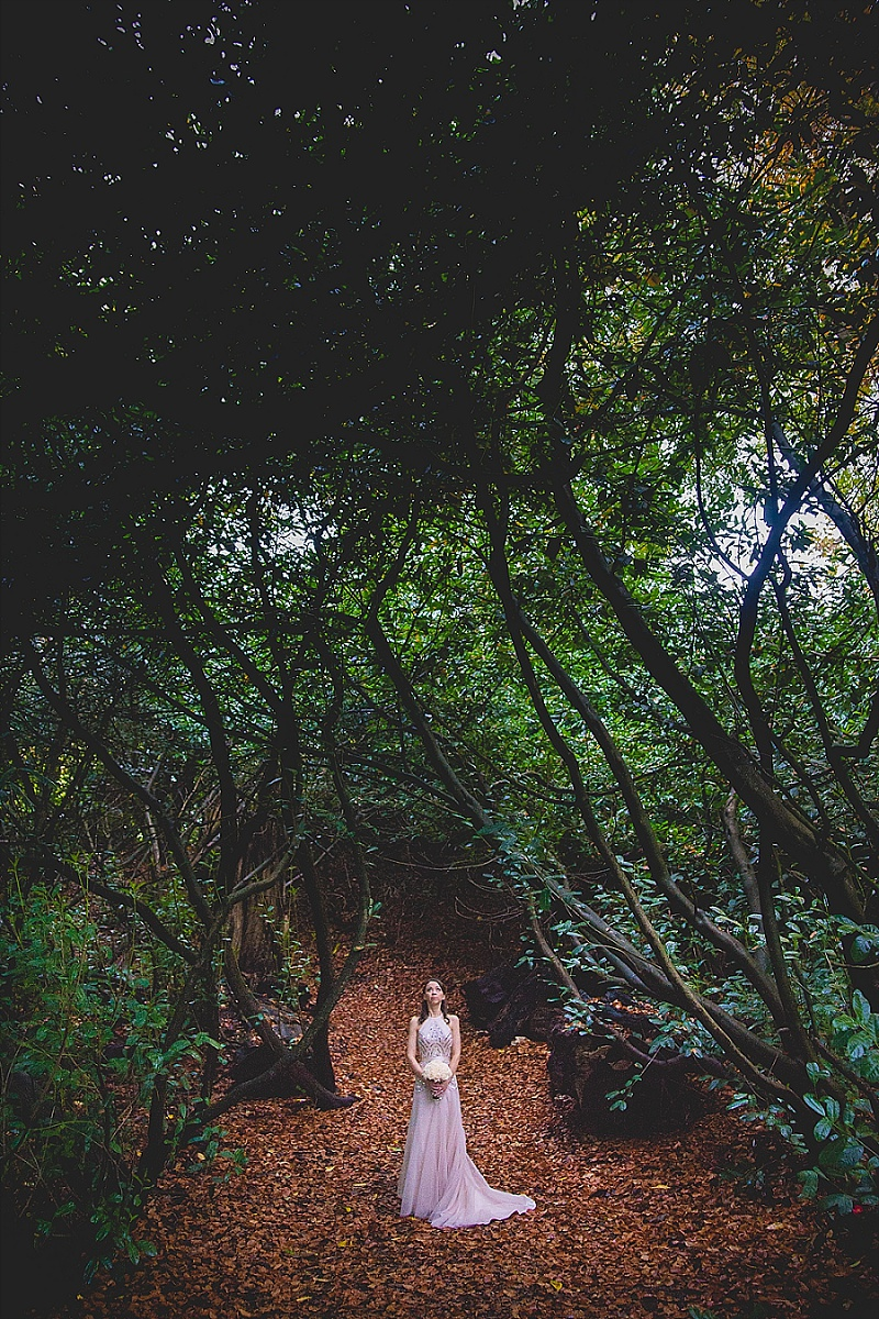 Bride in Vintage Dress in woodland Clearing