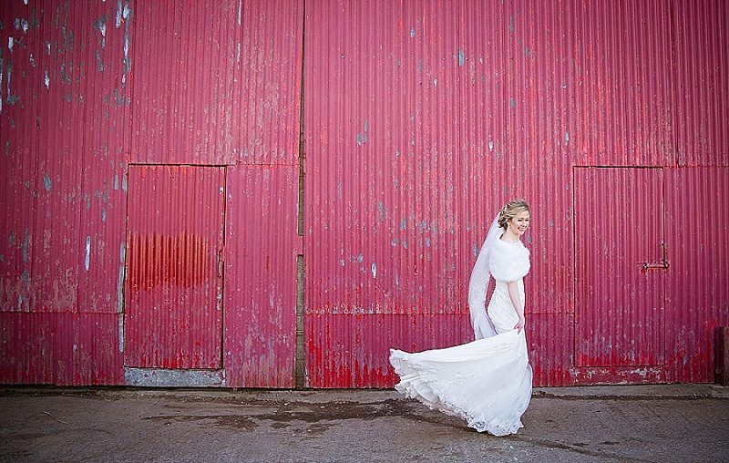 Winter bride in front of Red barn