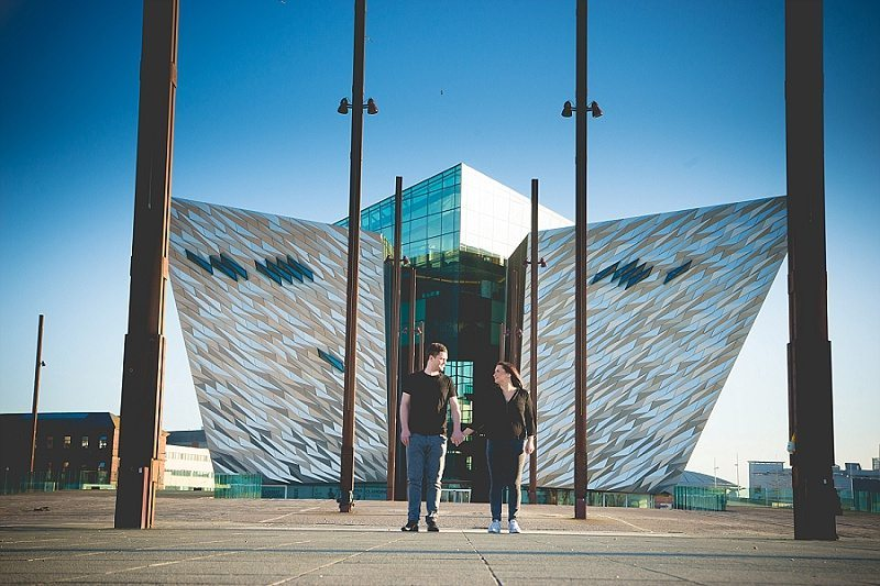 Couple holding hands on the slipway at Titanic Belfast