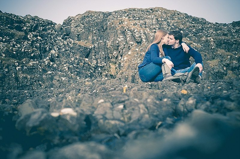 Couple stealing a kiss on rocks