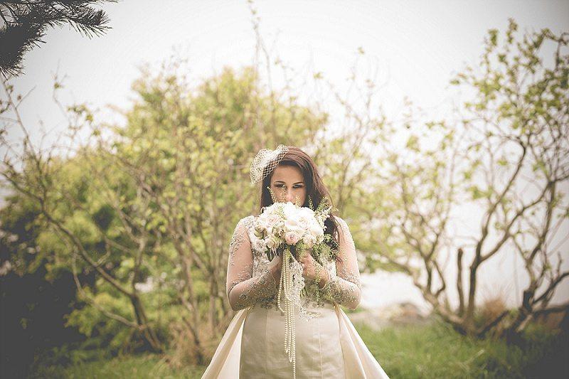 Vintage bride stood in woodland