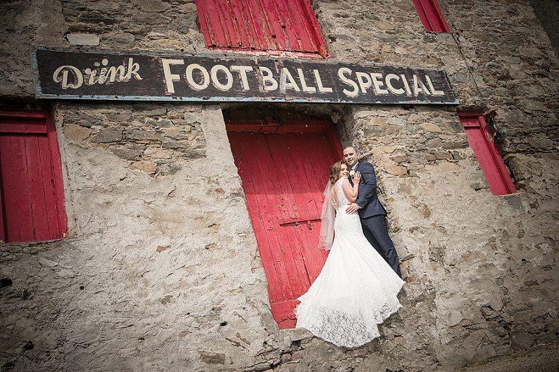 Bride and Groom in Doorway under Vintage sign