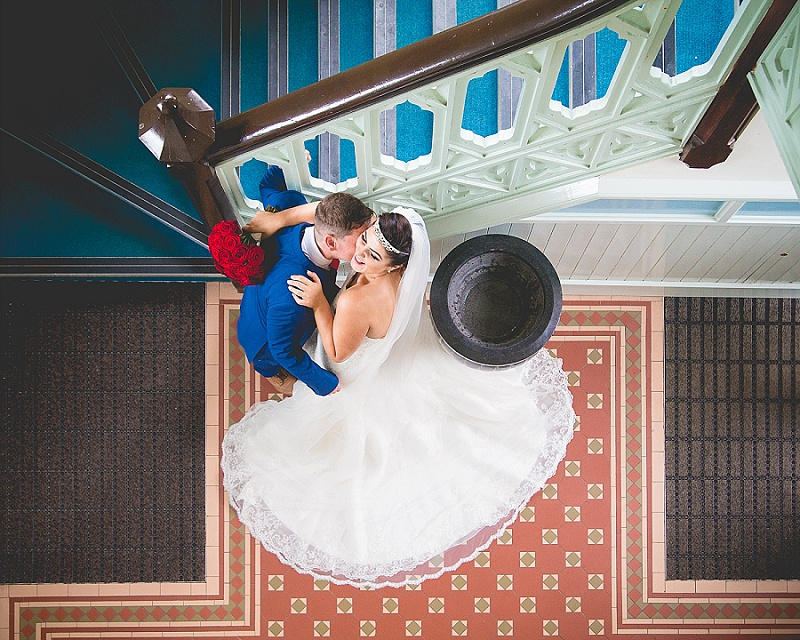 Bride and Groom stealing a kiss in Church Lobby
