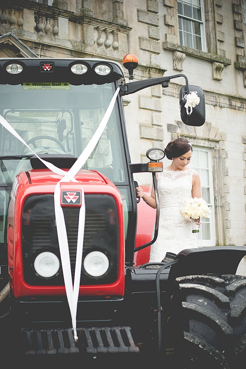 Bride stood on Red Wedding Tractor