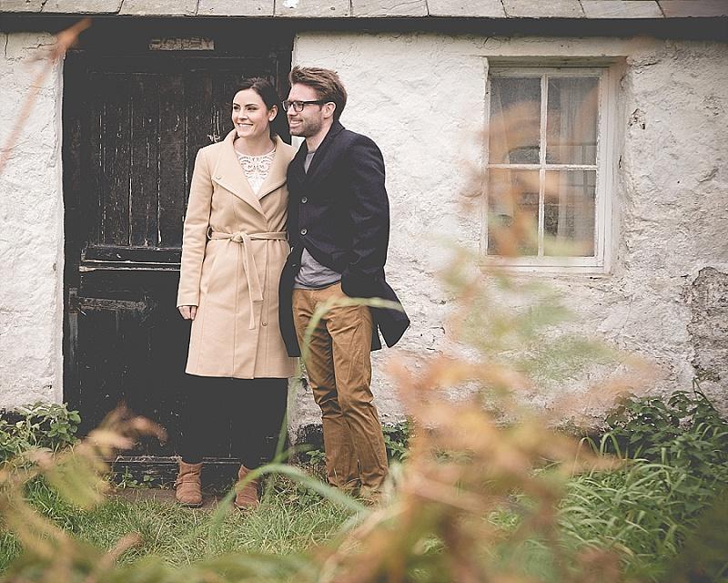 Couple outside old Irish Cottage