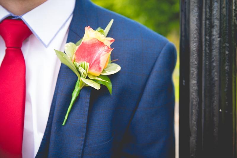 Man's Wedding Buttonhole Flower on Blue suit