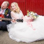 Groom plays guitar for bride on wedding day