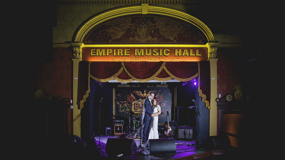 Alternative wedding couple on stage at the Empire Music Hall in Belfast