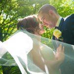 Bride with veil lit in sun