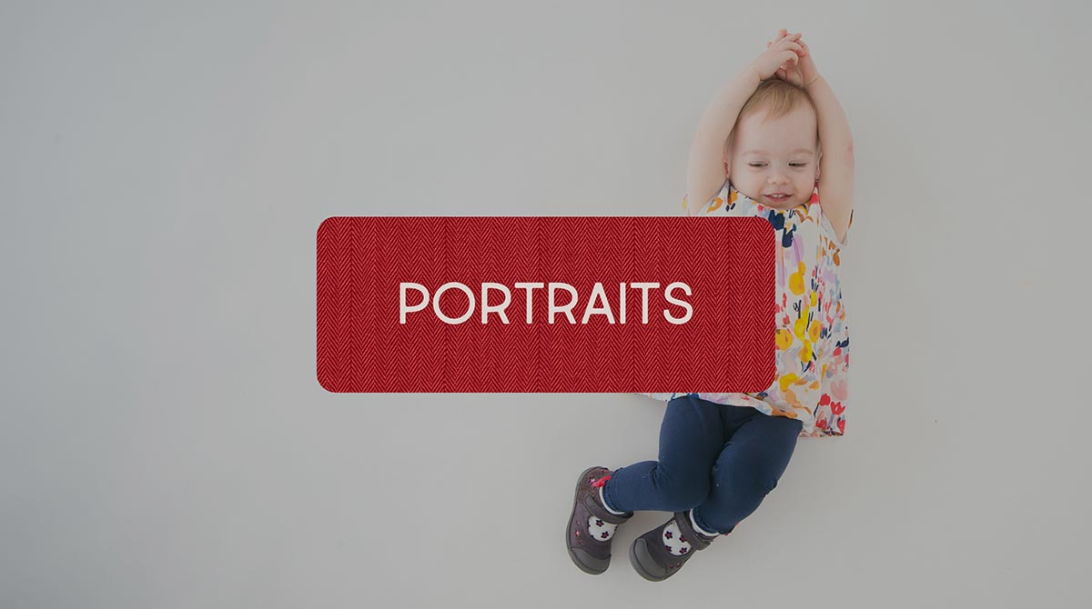 Little girl on the floor at a studio portrait