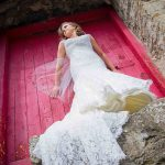 Dramatic shot of bride standing in rustic door