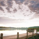 Bride sitting relaxing on pier