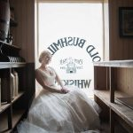 Bride sitting in Irish pub