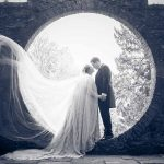Bride and groom in circle kissing