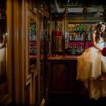 Bride sits on bar top in Irish bar