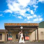 Wedding couple kiss at disused derelict gas station
