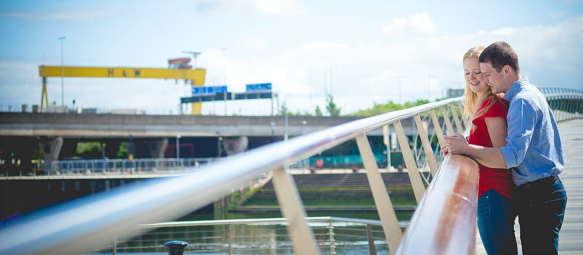 Engagement shoot over looking Lagan river with Harland and Wolff Crane in back ground