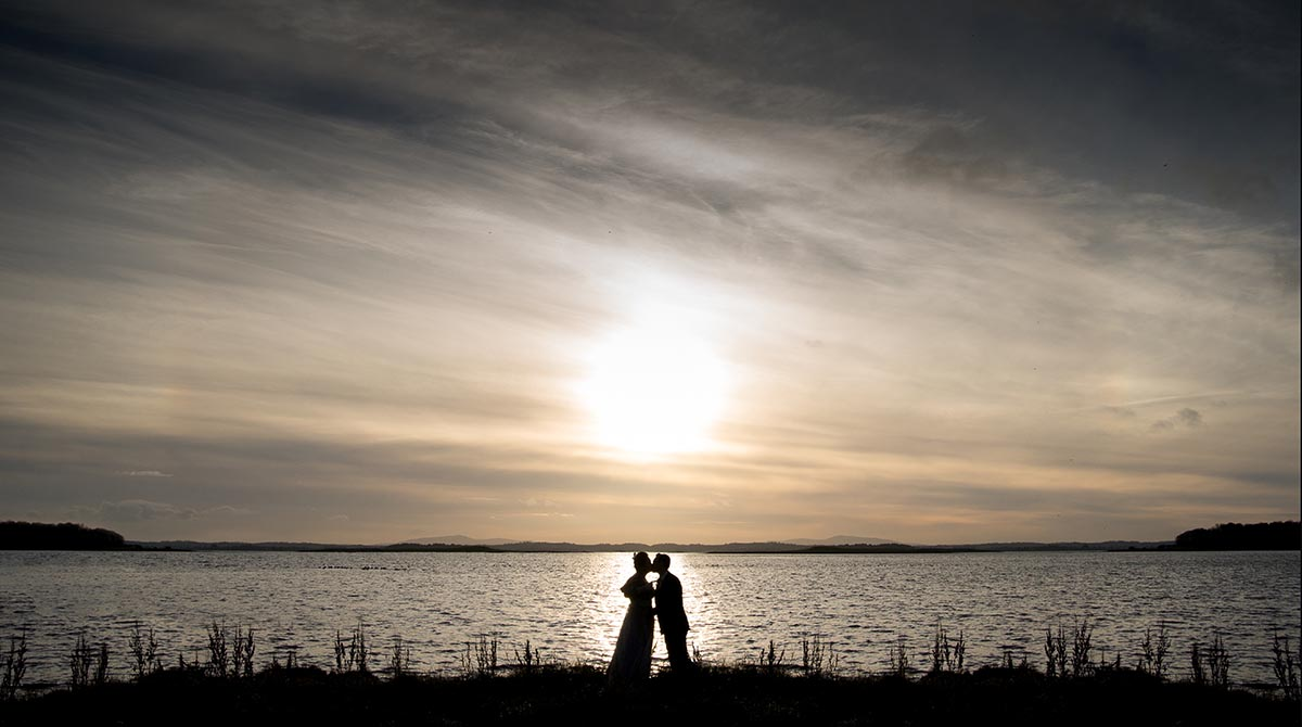 Silhouette of bride and groom at Orange Tree House on Strangford Lough