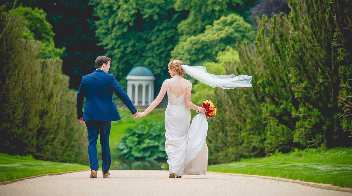 Wedding couple walk in Hillsborough Castle grounds
