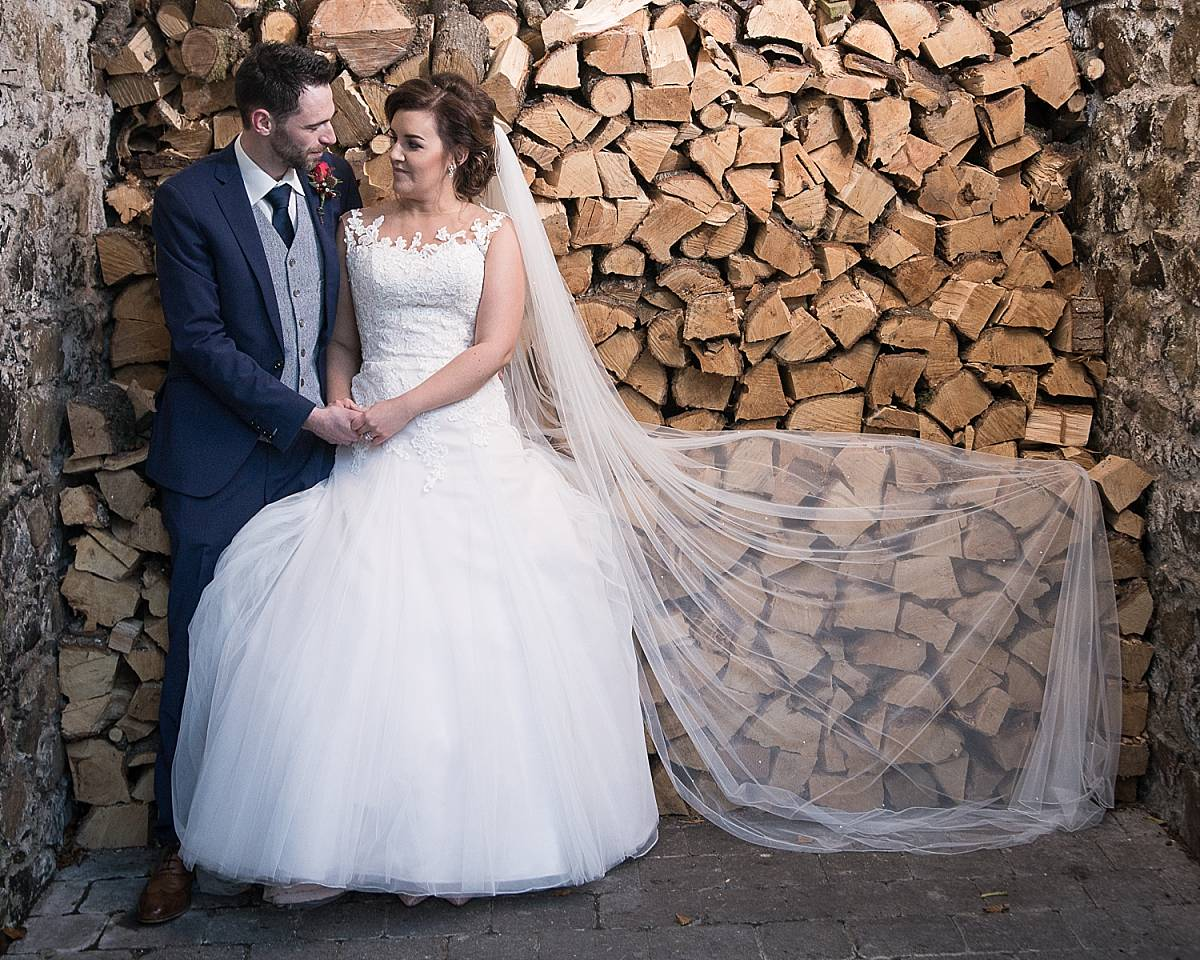 Bride and groom in a woodshed