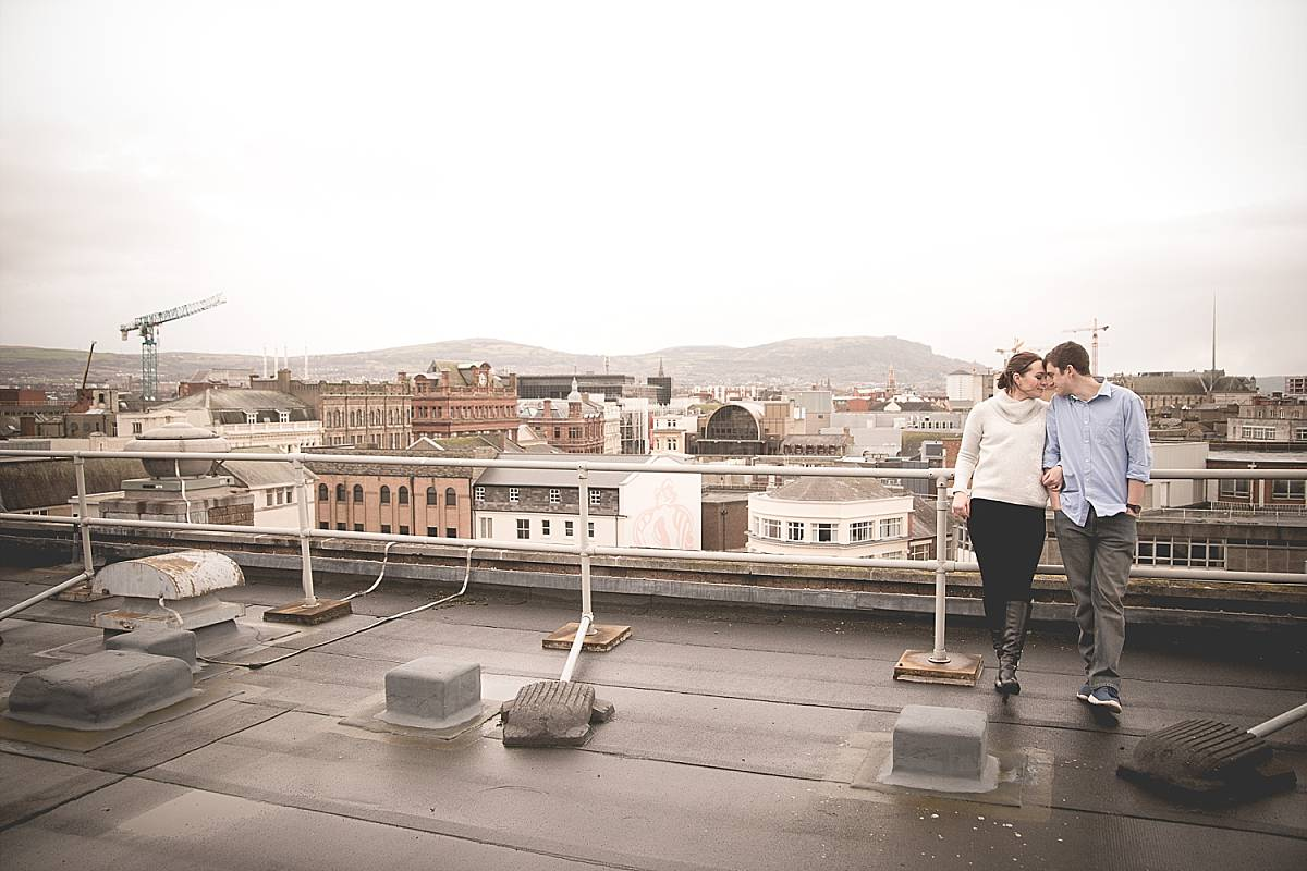 Couple on roof with Belfast behind