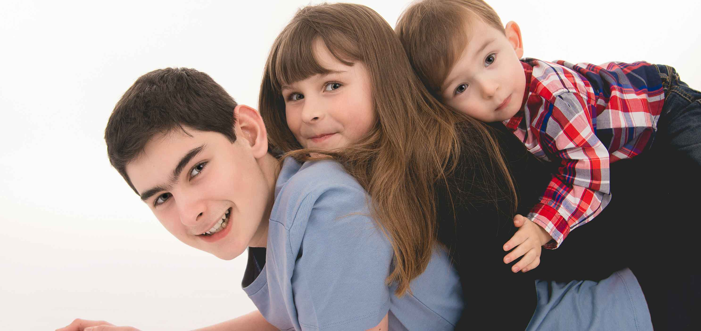 Young family posing for a family portrait in Belfast photography studio